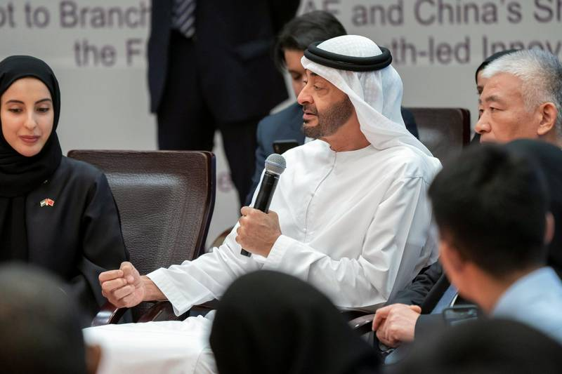 BEIJING, CHINA - July 23, 2019: HH Sheikh Mohamed bin Zayed Al Nahyan, Crown Prince of Abu Dhabi and Deputy Supreme Commander of the UAE Armed Forces (C), attends the UAE-China youth symposium, at Tsinghua University. Seen with HE Shamma Suhail Al Mazrouei, UAE Minister of State for Youth Affairs (L).  ( Rashed Al Mansoori / Ministry of Presidential Affairs ) ---