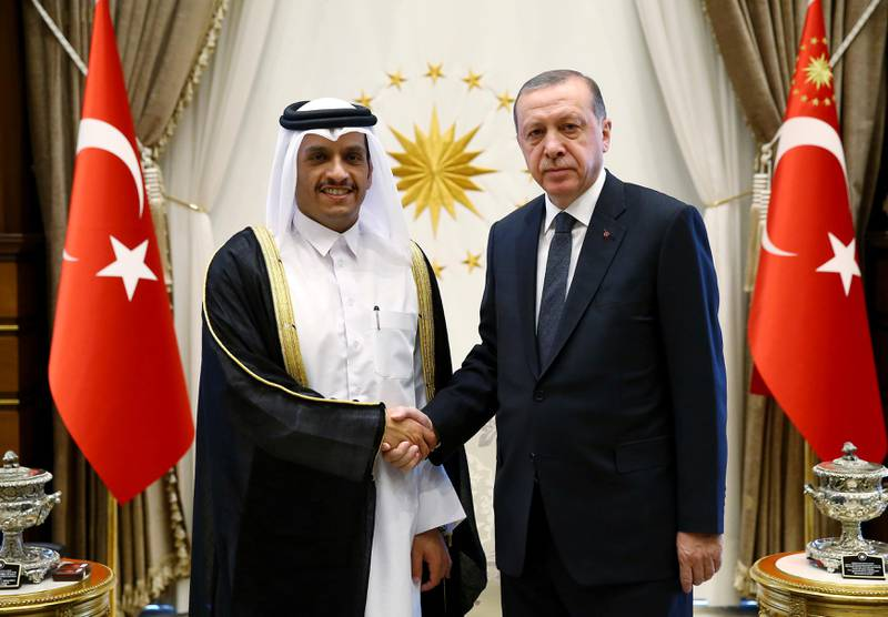 Turkey's President Recep Tayyip Erdogan, right, shakes hands with Qatar's Foreign Minister Sheikh Mohammed bin Abdulrahman Al Thani, prior to their talks at the Presidential Palace in Ankara, Turkey, Tuesday, Sept. 12, 2017.  The meeting took place amid a public row which erupted on live television between top diplomats from Qatar and four Arab nations over allegations it funds extremist groups. (Presidency Press Service via AP, Pool)