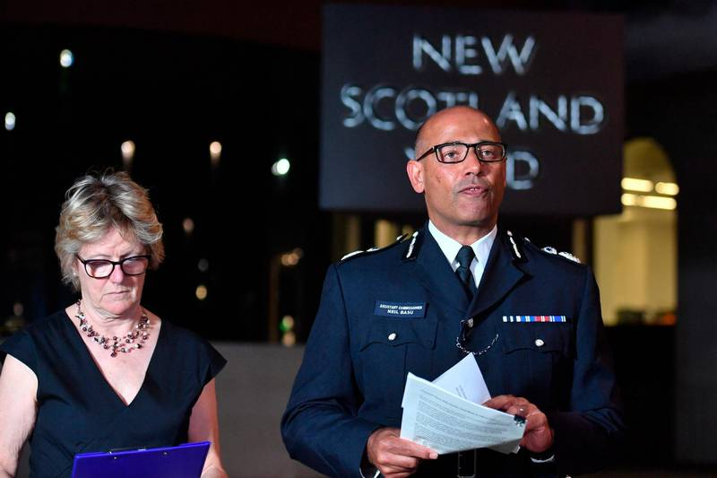 The UK's head of counter-terrorism policing Neil Basu, right, and chief medical officer for England Dame Sally Davies speaking at a news conference at New Scotland Yard in London, Wednesday, July 4, 2018.  British police say couple who are critically ill were exposed to Russian nerve agent Novichok. (John Stillwell/PA via AP)