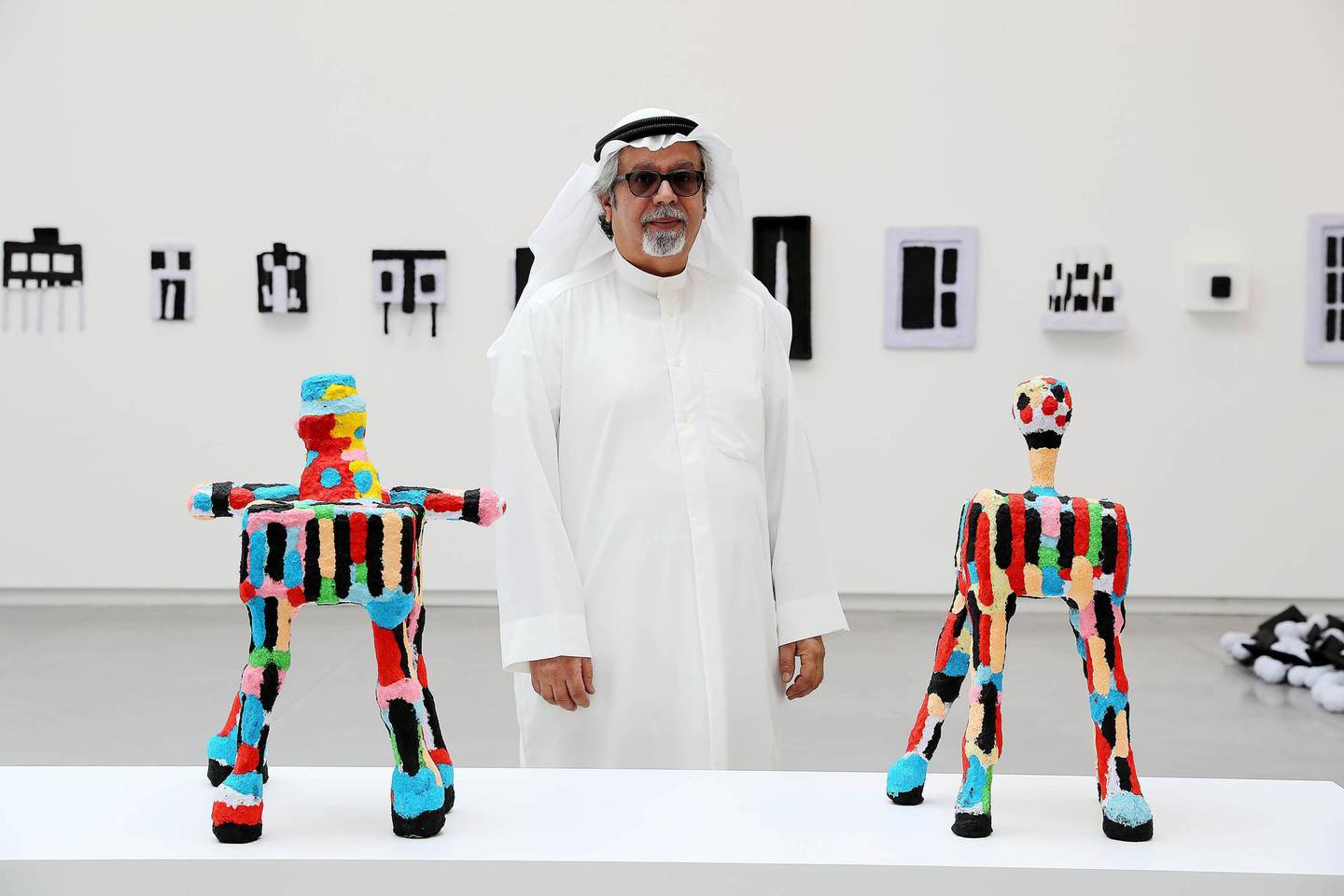 SHARJAH , UNITED ARAB EMIRATES , MARCH 15  – 2017 :- Mohamed Ahmed Ibrahim , artist with his work during the opening of the exhibition at Sharjah Art Foundation in Sharjah. ( Pawan Singh / The National ) For Arts & Life. Story by Melissa