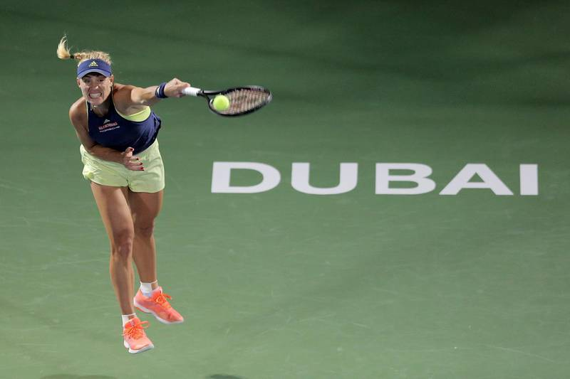 epa06546954 Angelique Kerber of Germany in action against Barbora Strycova of Czech Republic during their first round match of the WTA Dubai Duty Free Tennis Championships at the Dubai Tennis Stadium, United Arab Emirates, 20 February 2018.  EPA/MAHMOUD KHALED