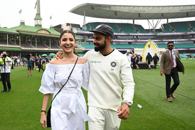 (FILES) In this file photo taken on January 07, 2019 India's captain Virat Kolhi and his wife Anushka Sharma walk on the field as they celebrate India's series win on the fifth day of the fourth and final cricket Test against Australia at the Sydney Cricket Ground in Sydney. The 32-year-old and his Bollywood actress wife Anushka Sharma are expecting a baby in January and Kohli has been given permission by the Indian cricket board to return home after the first Test in Adelaide, which begins on December 17, 2020. - -- IMAGE RESTRICTED TO EDITORIAL USE - STRICTLY NO COMMERCIAL USE --  / AFP / Peter PARKS / -- IMAGE RESTRICTED TO EDITORIAL USE - STRICTLY NO COMMERCIAL USE --