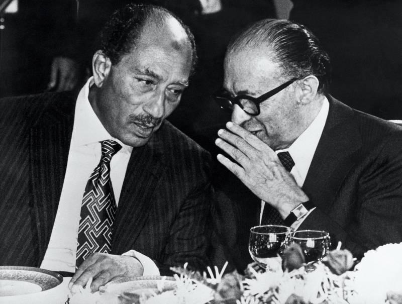 Egyptian President Anouar el-Sadate (L) meets Israeli Prime minister Menahem Begin in Tel Aviv on November 23, 1977. (Photo by STF / AFP)
