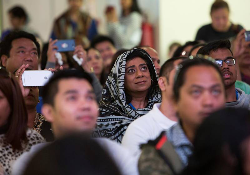 DUBAI, UNITED ARAB EMIRATES - Worshippers listening to the mass  by  Pope  Francis on the screen at St. Mary's Church, Oud Mehta.  Leslie Pableo for The National for Ramolas story