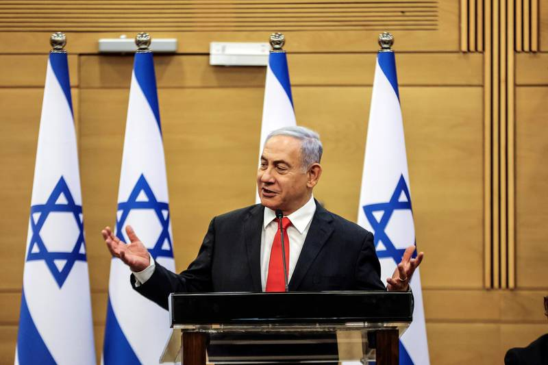Leader of Israeli Opposition Benjamin Netanyahu speaks during a meeting with his Likud party in the Knesset, the Israeli parliament, in Jerusalem June 14, 2021. REUTERS/Ronen Zvulun