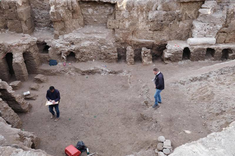 Antiquities Department employees survey a section of the Roman baths in downtown Amman, Jordan. Amy McConaghy / The National