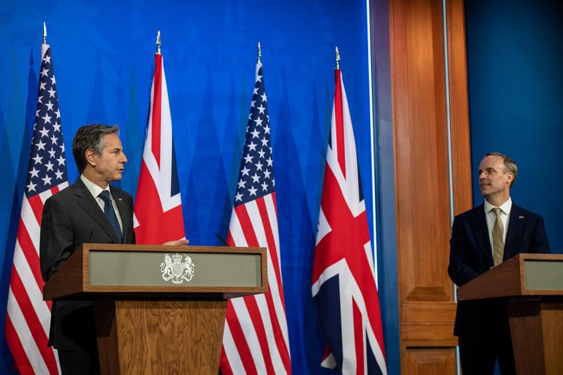 LONDON, ENGLAND - MAY 03: UK Foreign Secretary, Dominic Raab, (R) and US Secretary of State, Antony Blinken, (L) hold a joint press conference at Downing Street on May 3, 2021 in London, England. This is the first visit to the UK by US Secretary of State, Antony Blinken, since his appointment by US President, Joe Biden. (Photo by Chris J Ratcliffe/Getty Images)