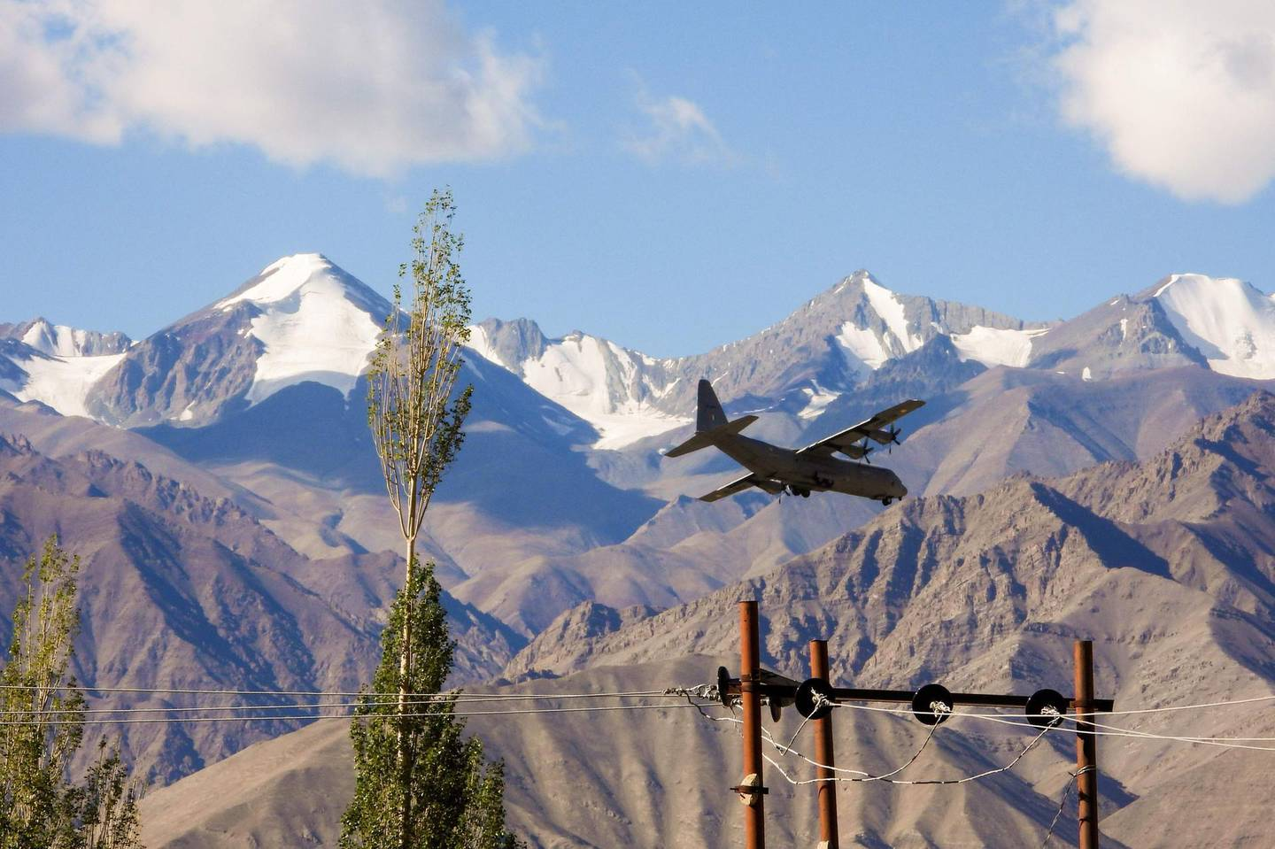 """An Indian Air Force Hercules military transport plane prepares to land at an airbase in Leh, the joint capital of the union territory of Ladakh bordering China, on September 8, 2020. China on September 8 said its troops were forced to take """"countermeasures"""" after Indian soldiers crossed their tense Himalayan border and opened fire. The relationship between the two nuclear-armed neighbours has deteriorated since a clash in the Ladakh region on June 15 in which 20 Indian troops were killed. / AFP / Mohd Arhaan ARCHER"""
