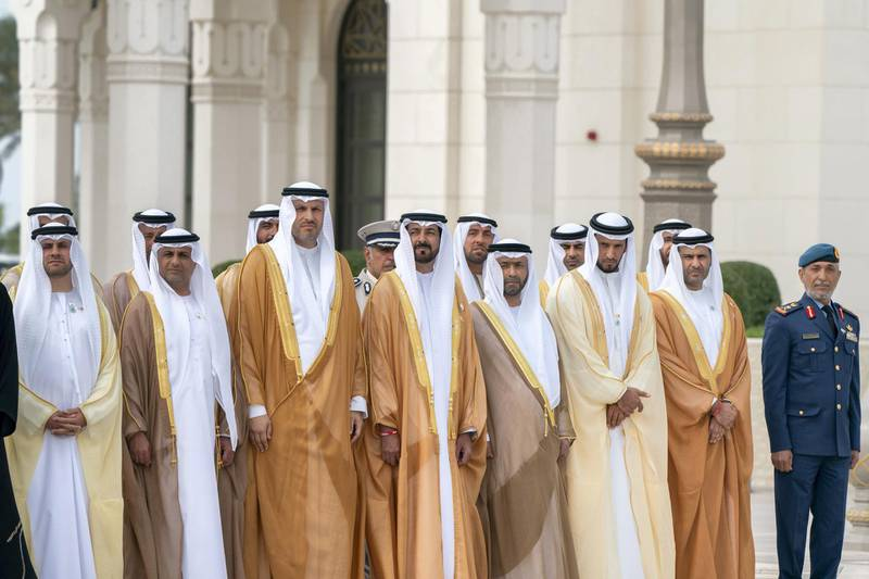 ABU DHABI, UNITED ARAB EMIRATES - February 4, 2019: Day two of the UAE papal visit - (R-L) HE Major General Essa Saif Al Mazrouei, Deputy Chief of Staff of the UAE Armed Forces, HE Saif Mohamed Al Hajeri, Chairman of Department of Economic Development, and Abu Dhabi Executive Council Member, HE Sheikh Abdulla bin Mohamed Al Hamed, Chairman of the Health Department and Abu Dhabi Executive Council Member, HE Hamad Mohamed Al Hurr Al Suwaidi, HE Mubarak Rashid Al Mansouri, Governor of the UAE Central Bank, HE Khaldoon Khalifa Al Mubarak, CEO and Managing Director Mubadala, Chairman of the Abu Dhabi Executive Affairs Authority and Abu Dhabi Executive Council Member, HE Jassem Mohamed Bu Ataba Al Zaabi, Chairman of Abu Dhabi Executive Office and Abu Dhabi Executive Council Member and HE Dr Ahmed Mubarak Al Mazrouei, Secretary General of the Abu Dhabi Executive Council, stand for a national anthem, during a reception for His Holiness Pope Francis, Head of the Catholic Church (not shown), at the Presidential Palace.  ( Mohamed Al Hammadi / Ministry of Presidential Affairs ) ---
