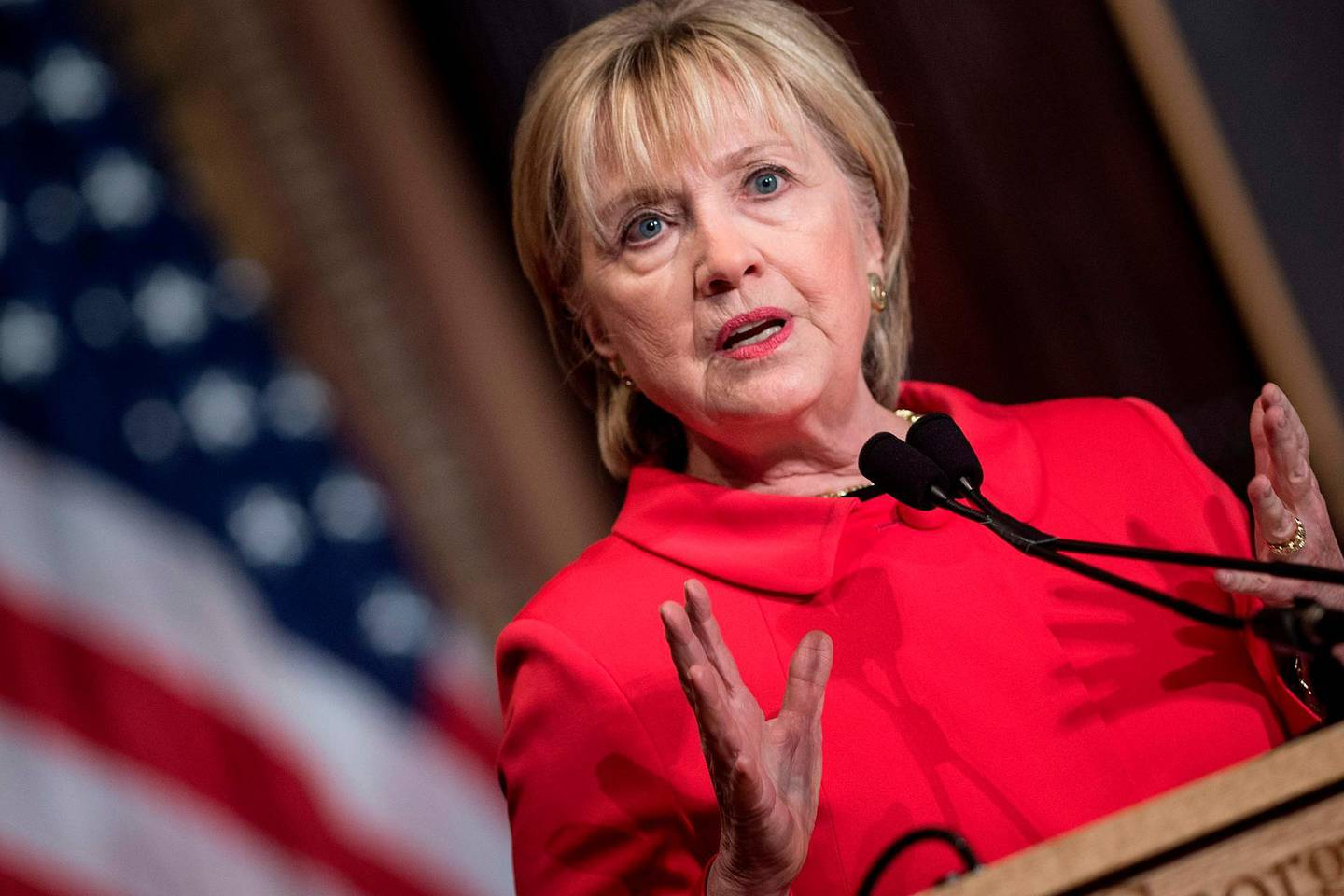 """(FILES) In this file photo taken on March 31, 2017 former US Secretary of State Hillary Clinton speaks during an awards ceremony for the Georgetown Institute for Women at Georgetown University on March 31, 2017 in Washington, DC. Hillary Clinton has for the first time ruled out running for president in 2020. """"I'm not running, but I'm going to keep on working and speaking and standing up for what I believe,"""" Clinton said March 4, 2019, in an interview with News 12, a local TV channel in New York. Clinton was the frontrunner in 2016 but ended up losing to Donald Trump. / AFP / Brendan Smialowski"""