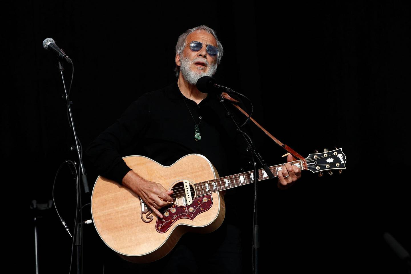 Yusof Islam, formerly known as Cat Stevens, performs at the national remembrance service for victims of the mosque attacks, at Hagley Park in Christchurch, New Zealand March 29, 2019. REUTERS/Edgar Su