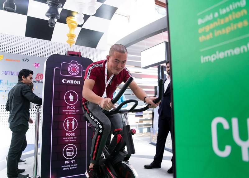 DUBAI, UNITED ARAB EMIRATES. 06 OCTOBER 2019. A man cycles to generate power at Dubai Internet City booth at Gitex Technology Week at Dubai World Trade Center.(Photo: Reem Mohammed/The National)Reporter:Section: