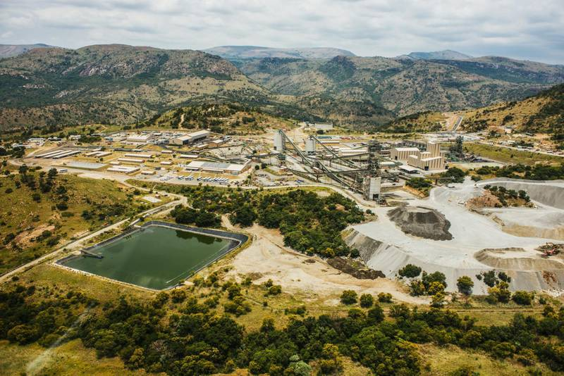The Northam Platinum Ltd. Booysendal platinum mine stands beyond a tailings dam for mining byproduct storage outside the town of Lydenburg in Mpumalanga, South Africa, on Tuesday, Jan. 23, 2018. Booysendal will use a system developed by an Austrian company that builds ski lifts to transport the ore up a 30 degree incline out of a valley for processing, instead of the traditional conveyer used throughout South Africa or the more expensive option of trucking. Photographer: Waldo Swiegers/Bloomberg