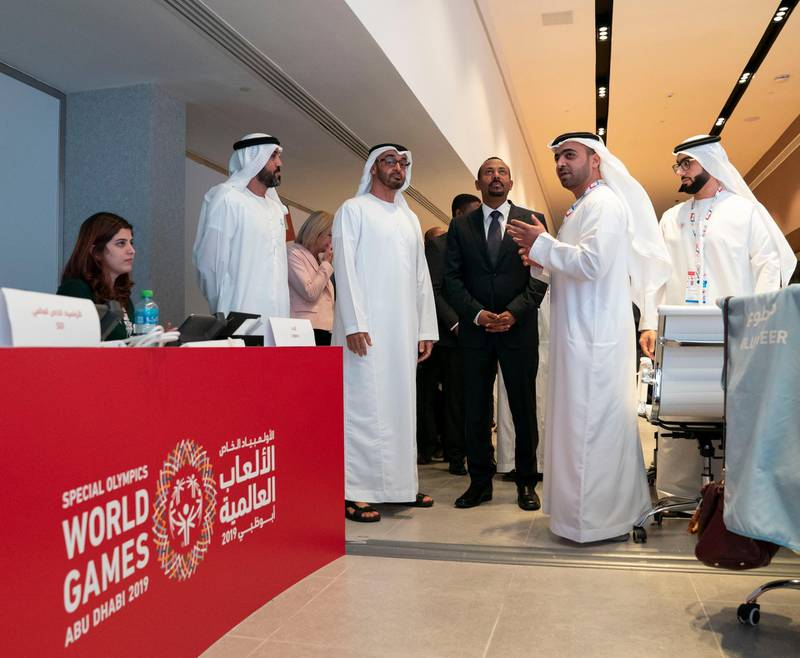 ABU DHABI, UNITED ARAB EMIRATES - March 20, 2019: HH Sheikh Mohamed bin Zayed Al Nahyan, Crown Prince of Abu Dhabi and Deputy Supreme Commander of the UAE Armed Forces (2nd L) and HE Abiy Ahmed, Prime Minister of Ethiopia (3rd L), tour the Special Olympics World Games Abu Dhabi 2019 at Abu Dhabi National Exhibition Centre. Seen with Khalfan Al Mazrouei, Managing Director at Special Olympics World Games Abu Dhabi 2019 (2nd R) and HE Mohamed Mubarak Al Mazrouei, Undersecretary of the Crown Prince Court of Abu Dhabi (L).   ( Mohamed Al Hammadi / Ministry of Presidential Affairs ) ---