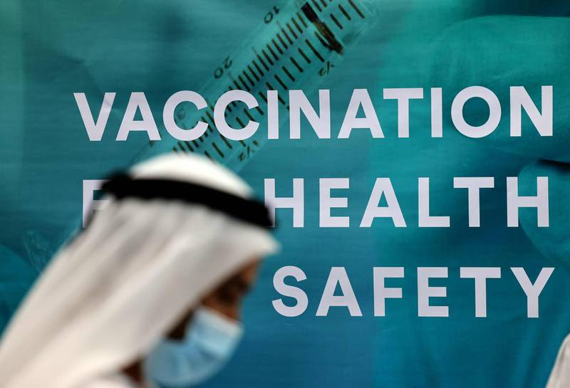 An Emirati man wearing a protective mask is pictured on February 3, 2021 at the COVID -19 vaccination hall at Dubai's Financial Centre. The United Arab Emirates is racing to roll out vaccines -- administering some 3.4 million doses of vaccine to its population of about 10 million, for the second-fastest delivery after Israel. / AFP / Karim SAHIB