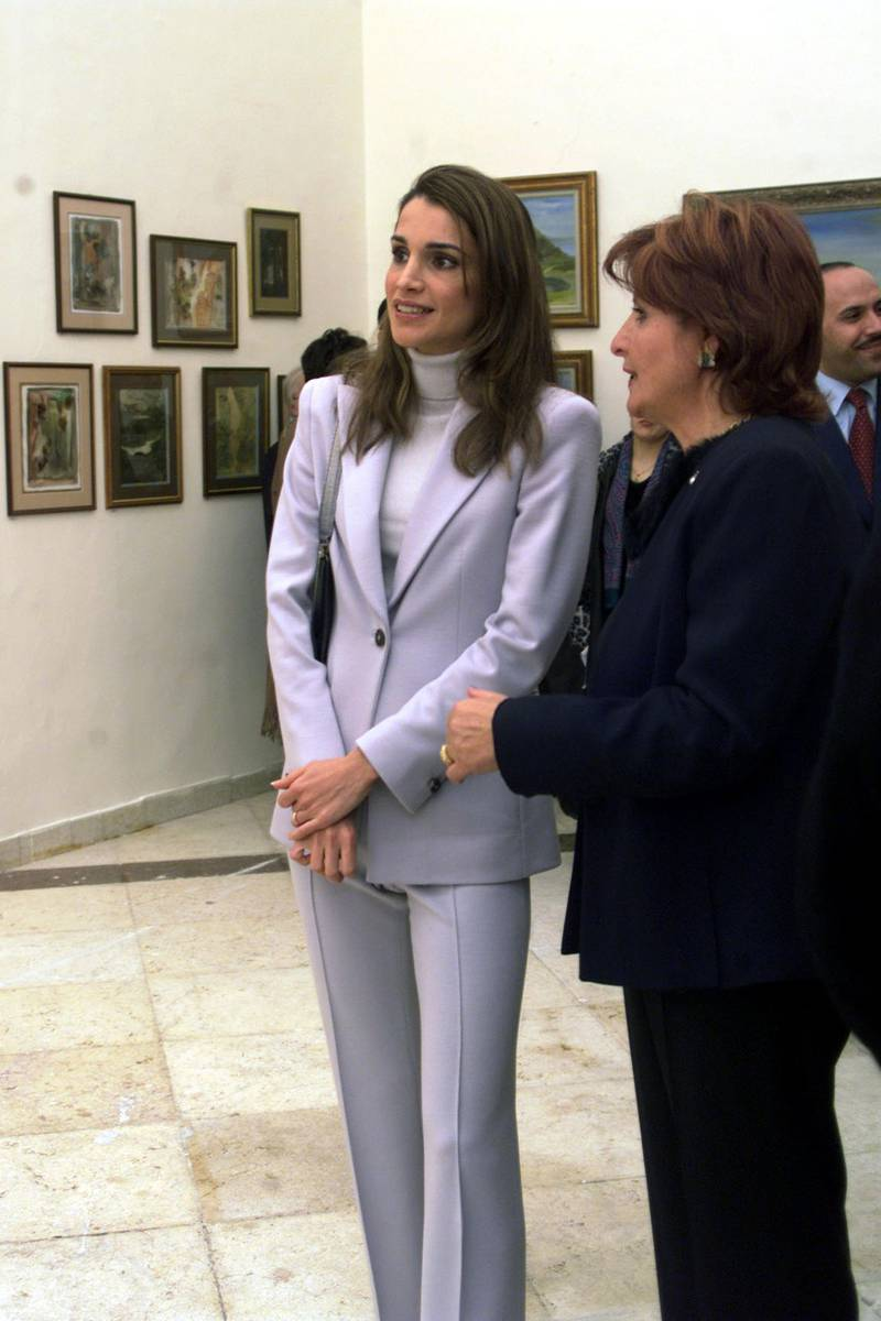 """397925 01: Queen Rania talks to Jordanian artist Hind Nasser during the opening of Nasser's exhibition """"The world around us"""" November 29, 2001 in Amman. The exhibition contains more than 100 paintings about Jordan. (Photo by Salah Malkawi/Getty Images)"""