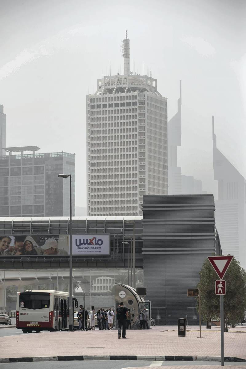 DUBAI, UNITED ARAB EMIRATES. 12 MARCH 2021. Dusty weather with wind in Dubai limits visability. (Photo: Antonie Robertson/The National) Journalist: None. Section: National.