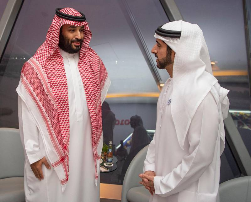 epa07189584 A handout photo made available by the Saudi Royal Court shows Saudi Crown Prince Mohammad Bin Salman (L) speaking with Hamdan bin Mohammed Al Maktoum, Crown Prince of Dubai (R) head of Chechen Republic during the Abu Dhabi Formula One Grand Prix 2018 at Yas Marina Circuit in Abu Dhabi, United Arab Emirates, 25 November 2018.  EPA/BANDAR ALGALOUD / SAUDI ROYAL COURT HANDOUT  HANDOUT EDITORIAL USE ONLY/NO SALES