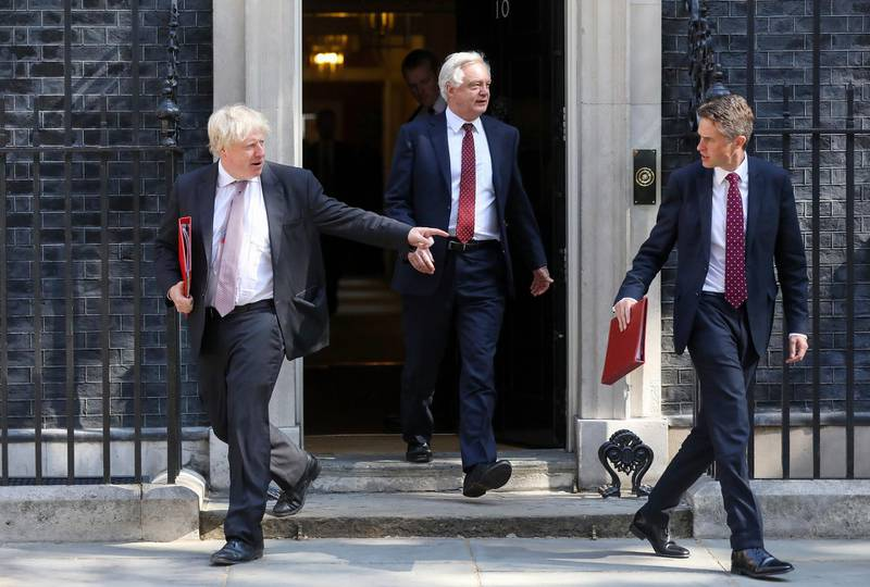 FILE: Boris Johnson, U.K. foreign secretary, left, David Davis, U.K. exiting the European Union (EU) secretary, centre, and Gavin Williamson, U.K. defence secretary, leave after attending a meeting of cabinet minsters at number 10 Downing Street in London, U.K., on Tuesday, July 3, 2018. U.K. Prime Minister Theresa May was plunged into a crisis after Brexit Secretary David Davis and his deputy resigned over her plans to keep close ties to the European Union after the divorce. The man who is going to inherit one of the toughest jobs in the U.K. -- negotiating Brexit -- is a 44-year-old former Foreign Office lawyer who entered Parliament in 2010: Dominic Raab. Our editors select the best archive images of Raab and Davis. Photographer: Chris Ratcliffe/Bloomberg