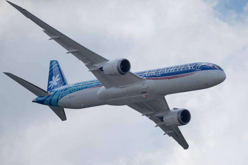 An Air Tahiti Nui Boeing 787-9 performs its flying display at the International Paris Air Show on June 17, 2019 at Le Bourget Airport, near Paris. (Photo by ERIC PIERMONT / AFP)