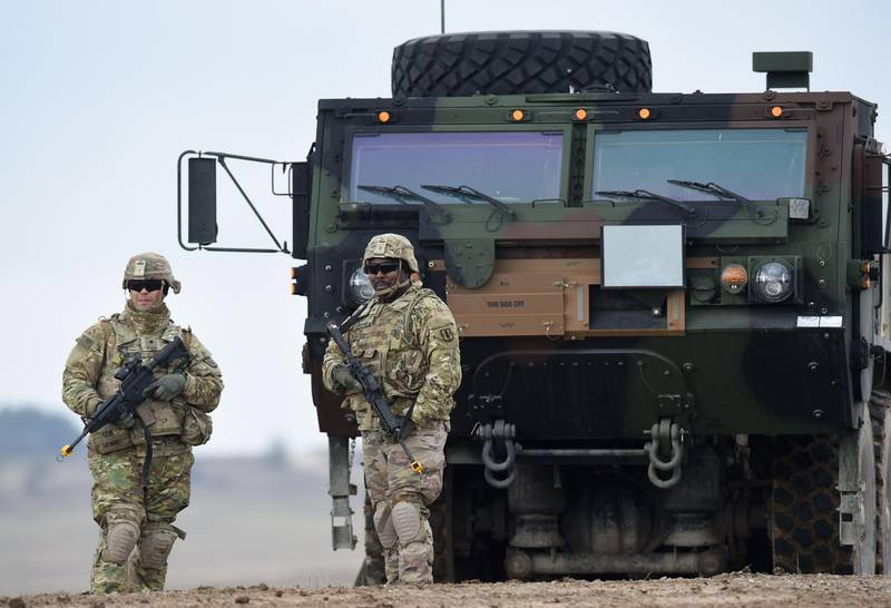 (FILES) In this file photo taken on March 04, 2020, US soldiers patrol prior to an artillery live fire event by the US Army Europe's 41st Field Artillery Brigade at the military training area in Grafenwoehr, Germany.  Germany on June 7, 2020, voiced concern at reports that US President Donald Trump plans to cut the number of US troops stationed in Germany, amid fears it could weaken a key pillar of NATO defence in the region. / AFP / Christof STACHE