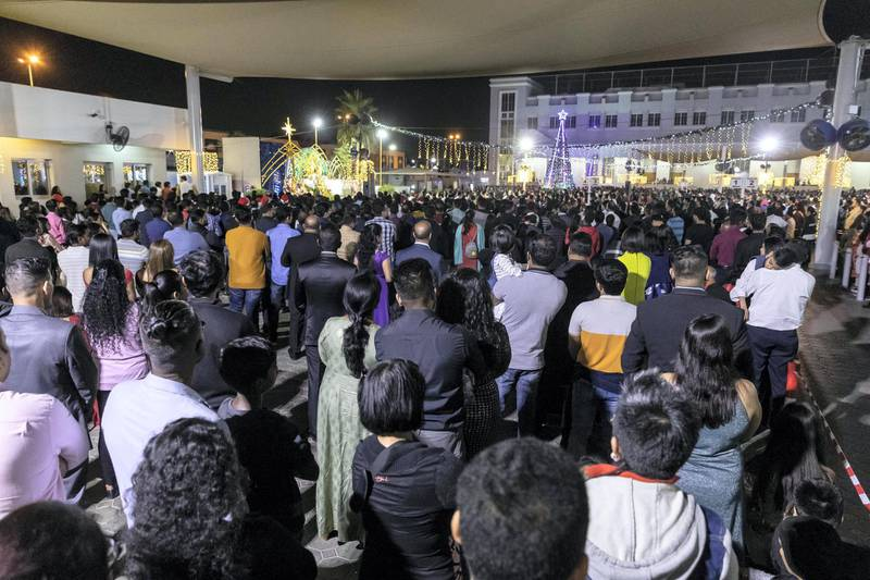 DUBAI, UNITED ARAB EMIRATES. 25 DECEMBER 2019. Midnight Mass at St Mary's in Dubai to celebrate Christmas. People stand patiently during the ceremony. (Photo: Antonie Robertson/The National) Journalist: None. Section: National.