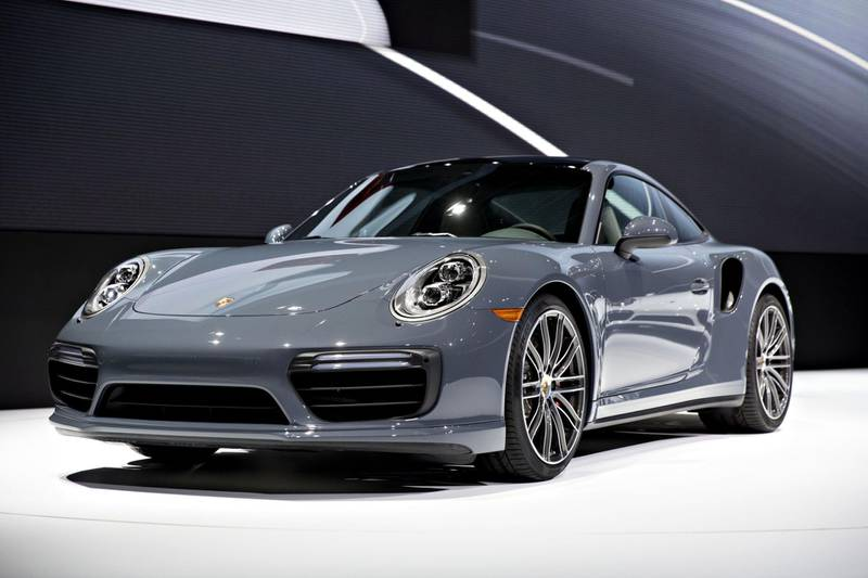 The Porsche AG 911 Turbo vehicle sits on stage during the debut at the 2016 North American International Auto Show (NAIAS) in Detroit, Michigan, U.S., on Monday, Jan. 11, 2016. Last year's auto show featured 55 vehicle introductions, a majority of which were worldwide debuts, and was attended by over 5,000 journalists from 60 countries. Photographer: Daniel Acker/Bloomberg
