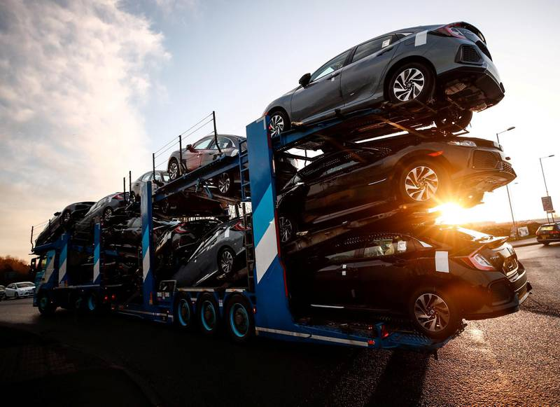 FILE PHOTO: A lorry with car carrier trailer leaves the Honda car plant in Swindon, Britain, February 18, 2019. REUTERS/Eddie Keogh/File Photo