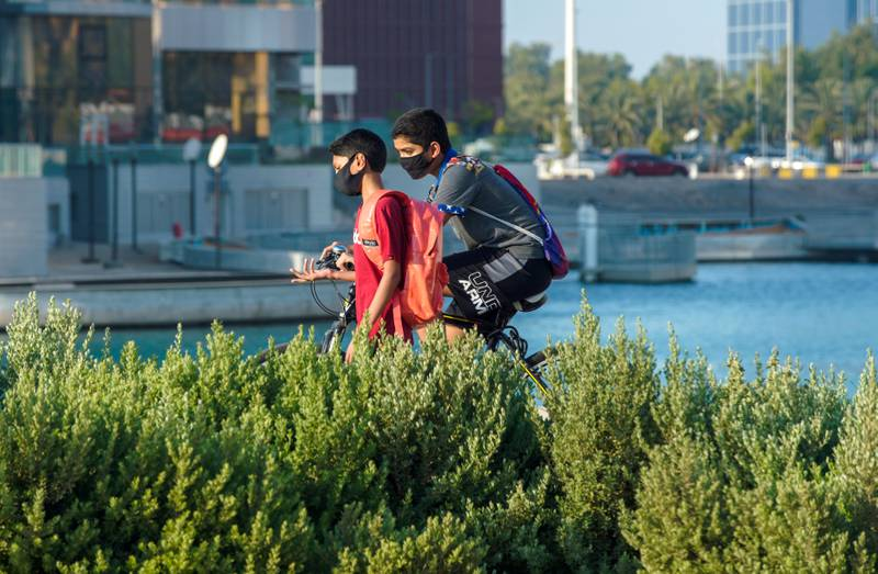 Abu Dhabi, United Arab Emirates, June 29, 2020.   Friends along the Ramada Hotel Abu Dhabi Corniche pathway as Covid-19 restrictions ease.Victor Besa  / The NationalSection:  NA / StandaloneReporter:  none