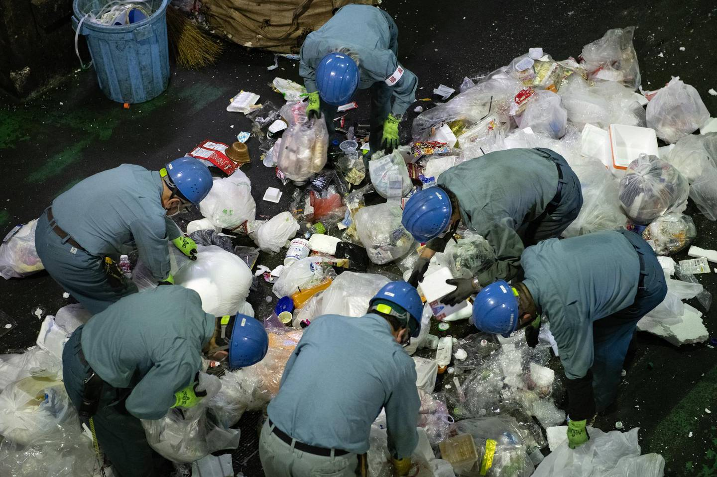 TOKYO, JAPAN - NOVEMBER 19: Workers sort through plastic household waste at Minato plastic household waste at Minato Resource Recycle Centre on November 19, 2020 in Tokyo, Japan. Despite its size, Japan is the world's second largest exporter of plastic waste after the USA and is second only to the US in consumption of single-use plastic packaging per person. Around 10 million tons of plastic is produced a year - the third highest amount in the world - with roughly three quarters being discarded within 12 months. Although the government has made efforts recently to address the issue, it declined, along with the USA, to sign a 2017 agreement between G7 countries to reduce the amount of plastic waste in the worlds oceans and cut down on the usage of single-use plastics, such as straws, bottles and cups. Japan has one of the lowest plastic recycling rates among OECD countries - with approximately 75 percent of waste sent to incinerators where it has to be burnt using ultra-high-temperature furnaces and filter systems to avoid releasing dioxins. However, the resulting exhaust fumes contribute to climate change. (Photo by Carl Court/Getty Images)