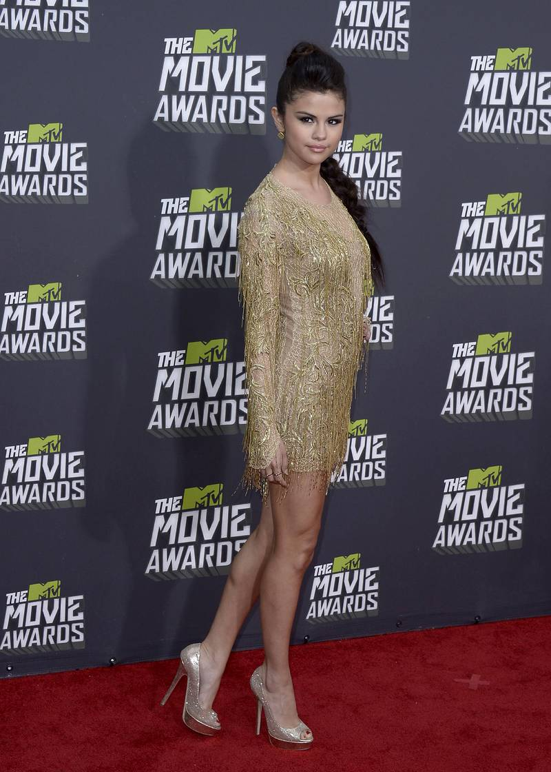 epa03662576 US singer and actress Selena Gomez arrives for the 2013 MTV Movie Awards in Culver City, California, USA, 14 April 2013.  EPA/PAUL BUCK