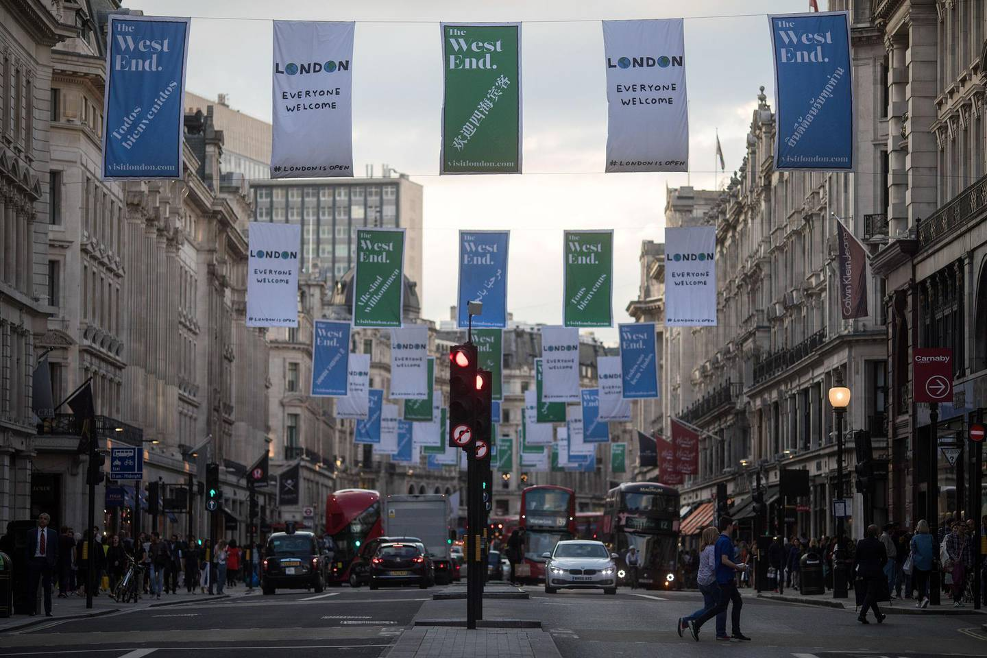 Banners advertising London's 'West End' shopping district hang above shoppers along Regent Street in central London, U.K., on Thursday, Aug. 31, 2017. U.K. consumer confidence staged a slight rebound from its lowest level since just after the Brexit vote. Photographer: Simon Dawson/Bloomberg