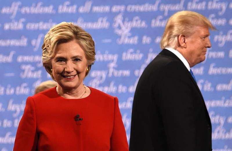 Democratic nominee Hillary Clinton (L) and Republican nominee Donald Trump leave the stage after the first presidential debate at Hofstra University in Hempstead, New York on September 26, 2016. (Photo by Timothy A. CLARY / AFP)