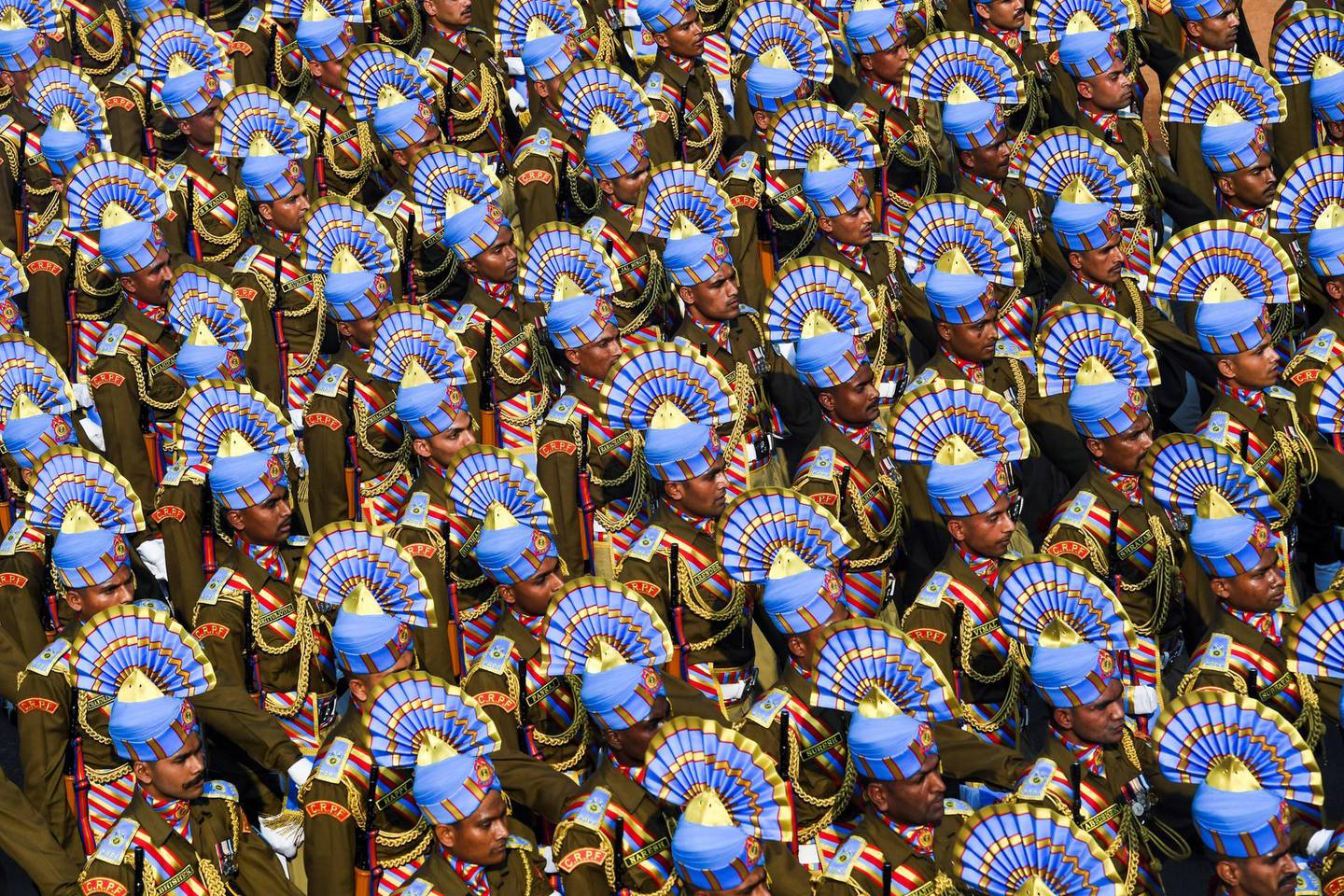 Soldiers march along Rajpath during the Republic Day parade in New Delhi on January 26, 2020. - Huge crowds gathered for India's Republic Day parade on January 26, with women taking centre-stage at the annual pomp-filled spectacle of military might featuring army tanks, horses and camels. (Photo by Prakash SINGH / AFP)