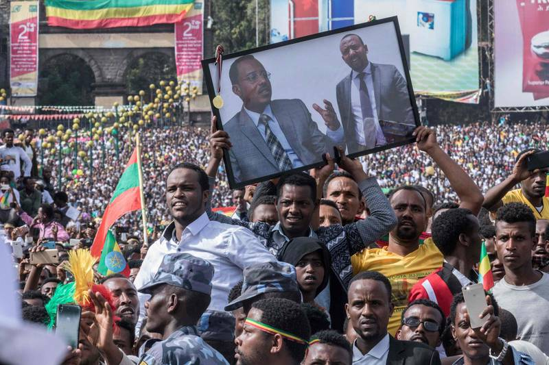 Supporters of Ethiopia Prime Minister attend a rally on Meskel Square in Addis Ababa on June 23, 2018. One person died and scores of others were hurt after a grenade blast at new Ethiopian Prime Minister Abiy Ahmed's first mass rally in the capital that sent crowds fleeing in panic. Abiy had just wrapped up his speech before tens of thousands of people in the heart of Addis Ababa when the explosion went off, sending droves of supporters towards the stage as the prime minister left hurriedly, an AFP correspondent said.  / AFP / YONAS TADESSE