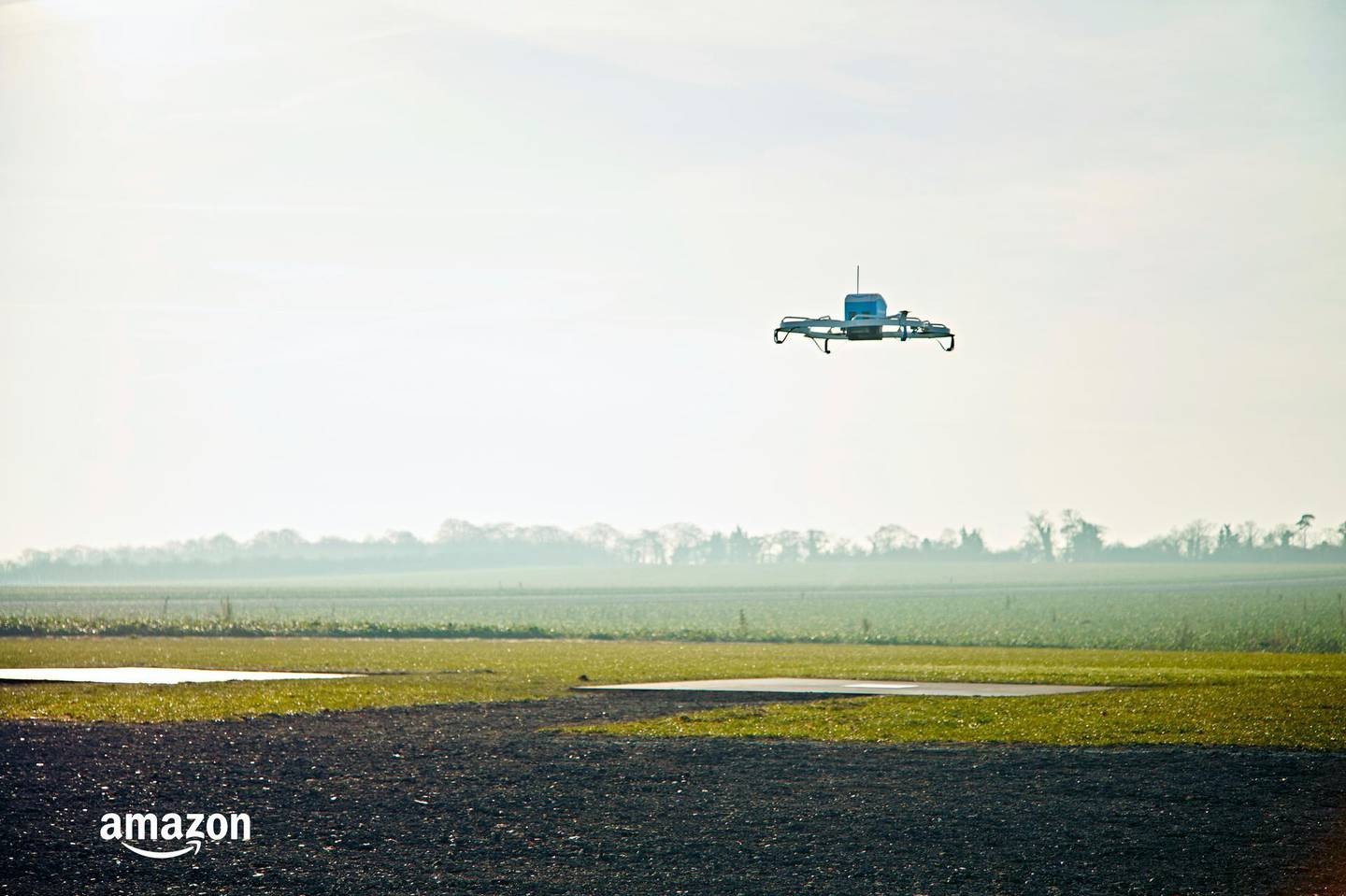 """FILE- This Dec. 7, 2016, file photo provided by Amazon shows an Amazon Prime Air drone in Cambridgeshire, United Kingdom. Amazon founder and CEO Jeff Bezos might have underestimated regulatory obstacles and privacy concerns when he told CBS' """"60 Minutes"""" in December 2013 that his company would be making drone-borne deliveries within five years. (Amazon via AP, File)"""