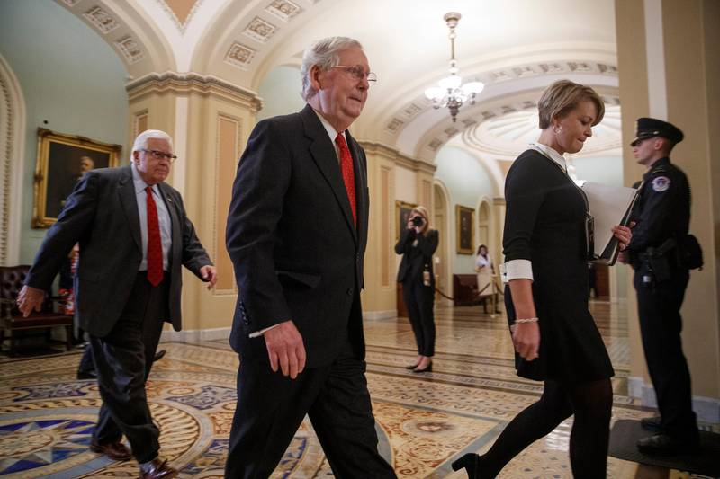 epa08149756 Senate Majority Leader Mitch McConnell (C) leaves the Senate floor following the first full day of the impeachment trial at the US Capitol in Washington, DC, 21 January 2020. The first full day of the Senate impeachment trial of US President Donald J. Trump was spent spent debating the rules for the proceedings with Senate Majority Leader Mitch McConnell pushing for two 12 hour days for each side to present their opening remarks.  EPA/SHAWN THEW
