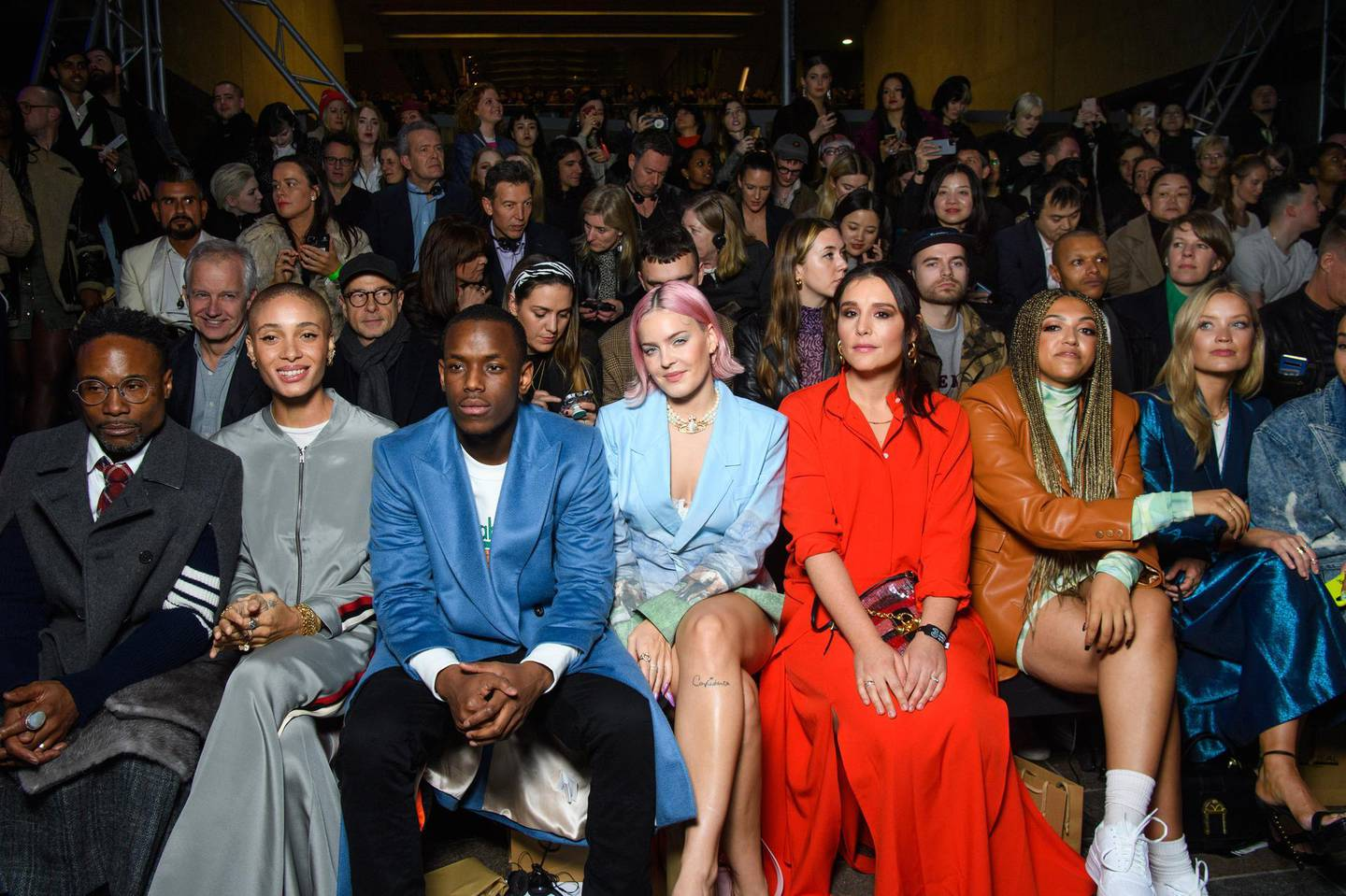 EDITORIAL USE ONLY (left to right) Billy Porter, Adwoa Aboah, Micheal Ward, Anne Marie, Jessie Ware, Mahalia and Laura Whitmore attend the Central Saint Martin's MA show at London Fashion Week as a digitally generated version of model Adwoa Aboah is unveiled, showcasing Three's 5G technology.