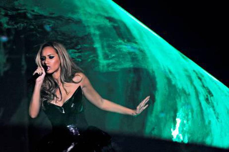 """British singer Leona Lewis performsduring the MTV Europe Music Awards 2009 for the """"Best Group"""" at the O2 Arena in Berlin on November 5, 2009. It was the second time that the MTV awards were held in Berlin -- part of efforts by the music industry to jump on the back of the Wall anniversary to boost flagging sales. AFP PHOTO DDP / POOL/ RAINER JENSEN  GERMANY OUT"""