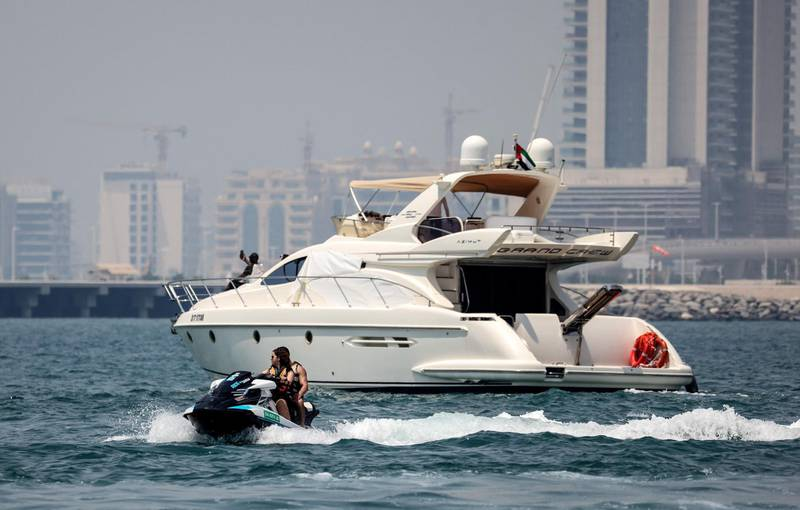A luxury yacht is pictured off the Dubai Marina Beach in the Gulf emirate, on June 10 2021. Dubai earned a reputation for delivering luxury for those with cash to splash years ago, but amid the Covid-19 pandemic, a new mode of travel has become popular, yachts. Charter companies said they have seen an increased interest in yachting after coronavirus measures eased, especially among those who want to spend time with friends and family. / AFP / Karim SAHIB