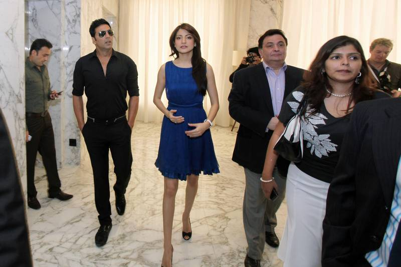 DUBAI, UNITED ARAB EMIRATES - FEBRUARY 9:  From left: Bollywood stars Akshay Kumar, Anushka Sharma, and Rishi Kapoor arrive at a press conference to launch the opening of their new film, Patiala House, at Le Meridien Hotel in Dubai on February 9, 2011.  (Randi Sokoloff for The National)  For News story by Ramola