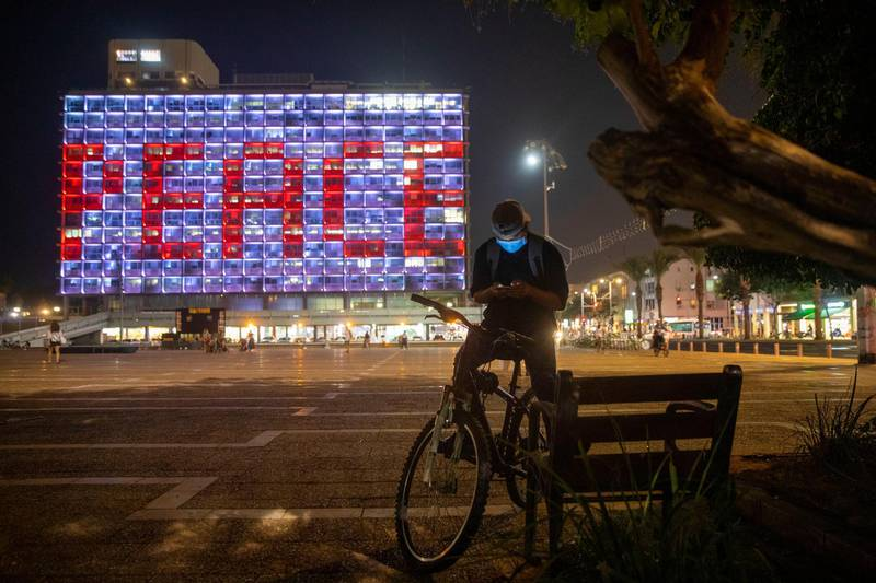 Tel Aviv City Hall is lit up with the words for peace in Hebrew, Arabic and English in honor of the recognition agreements Israel will be signing with the United Arab Emirates and Bahrain at the White House, in Tel Aviv, Israel, Tuesday, Sept. 15, 2020. (AP Photo/Oded Balilty)