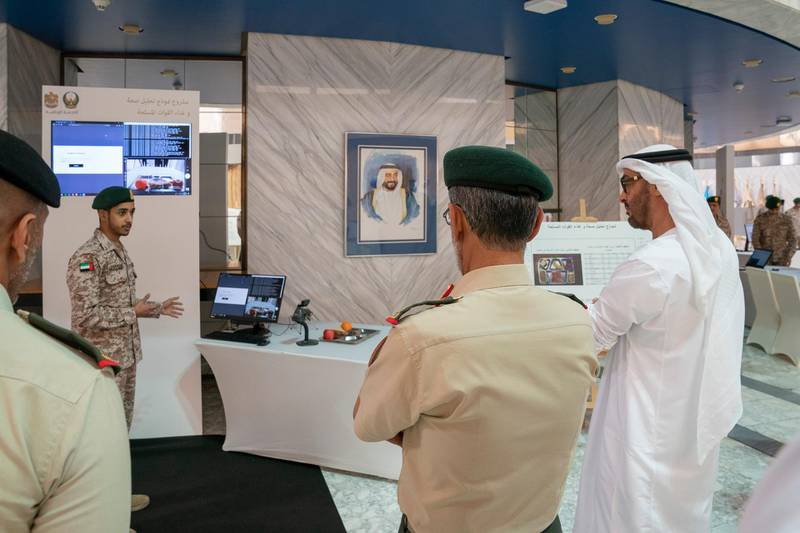 ABU DHABI, UNITED ARAB EMIRATES - April 28, 2019: HH Sheikh Mohamed bin Zayed Al Nahyan, Crown Prince of Abu Dhabi and Deputy Supreme Commander of the UAE Armed Forces (R), attends e-skills exhibition for national service recruits, at Armed Forces Officers Club. ( Mohamed Al Hammadi / Ministry of Presidential Affairs ) ---