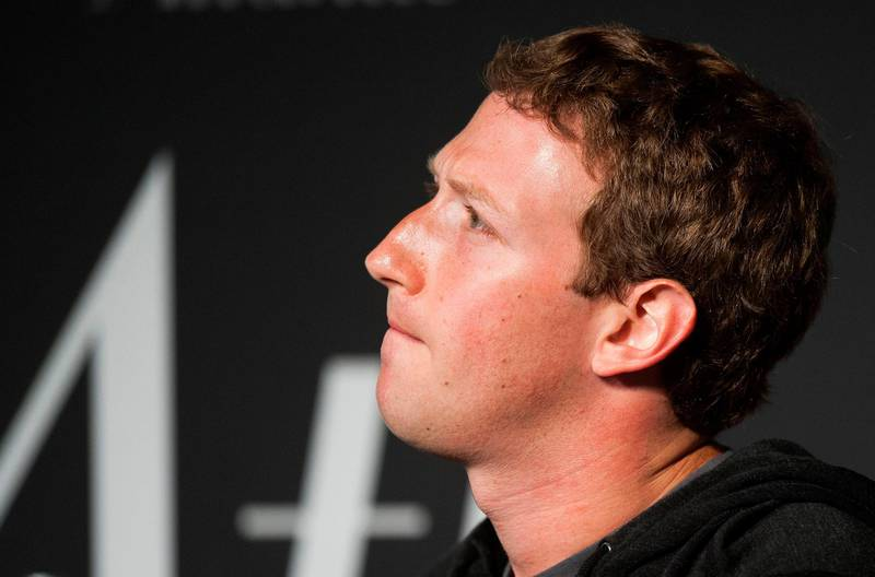 """(FILES) In this file photo taken on September 18, 2013 Facebook Founder and CEO Mark Zuckerberg speaks during an interview session with The Atlantic at the Newseum in Washington, DC. Facebook announced on April 6, 2018 that it will require any political ads on its platform to state who is paying for the message, and would verify the identity of the payer, in a bid to curb outside election interference.The social network, which is under fire for enabling manipulation of its platform in the 2016 election, said the new policy would require any messages for candidates or public issues to include the label """"political ad"""" with the name of the person or entity paying for it.  / AFP PHOTO / Jim WATSON"""