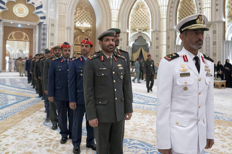 ABU DHABI, UNITED ARAB EMIRATES - May 20, 2018: HH Sheikh Saeed bin Hamdan bin Mohamed Al Nahyan, (R) and members of the UAE Armed Forces, attend an iftar reception at the Presidential Palace.   ( Mohamed Al Hammadi / Crown Prince Court - Abu Dhabi ) ---