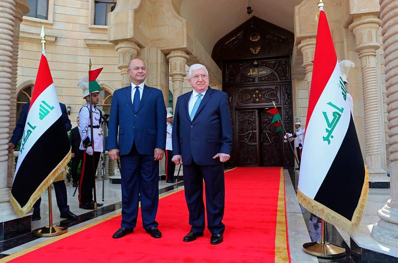 Former Iraqi President Fuad Masum, center, and newly elected Iraqi President Barham Salih, attend the inauguration ceremony in Baghdad, Iraq, Wednesday, Oct. 3, 2018. Iraq's new president is set to take office after tapping Adel Abdul-Mahdi, 76, an independent Shiite politician and former vice president for the post of prime minister. (AP Photo/Khalid Mohammed)