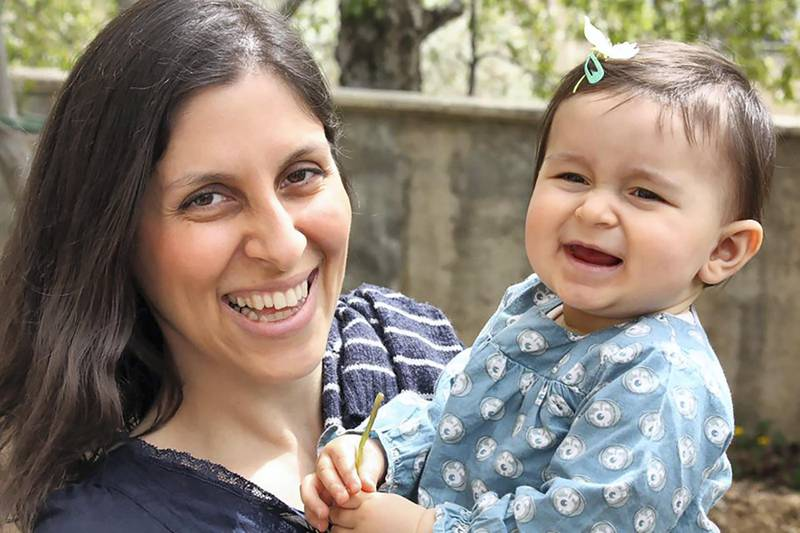 """An undated handout image released by the Free Nazanin campaign in London on June 10, 2016 shows Nazanin Zaghari-Ratcliffe (L) posing for a photograph with her daughter Gabriella. - Richard Ratcliffe told AFP that his wife, aged 37 and holds dual Iranian- British nationality (not recognized in Iran), was arrested on April 3 at Tehran airport as she was preparing to return to the UK with her daughter, then aged 22 months, after a visit to his family in Iran. (Photo by Handout / Free Nazanin campaign / AFP) / RESTRICTED TO EDITORIAL USE - MANDATORY CREDIT """"AFP PHOTO / FREE NAZANIN CAMPAIGN """" - NO MARKETING - NO ADVERTISING CAMPAIGNS - DISTRIBUTED AS A SERVICE TO CLIENTS"""
