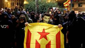Police and protesters clash as thousands flood Barcelona for separatist rally
