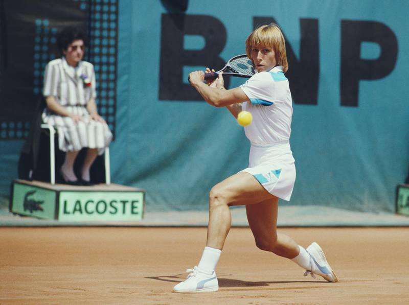 Martina Navratilova of the United States makes a backhand return against Chris Evert during their Women's Singles Final match at the French Open Tennis Championship on 9 June 1984 at the Stade Roland Garros Stadium in Paris, France. (Photo by Steve Powell/Allsport/Getty Images)