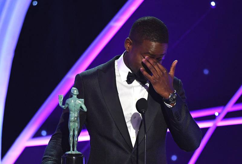 TOPSHOT - Sterling K. Brown accepts the Outstanding Performance by a Male Actor in a Drama Series award for 'This Is Us' onstage during the 24th Annual Screen Actors Guild Awards show at The Shrine Auditorium on January 21, 2018 in Los Angeles, California. / AFP PHOTO / Mark RALSTON